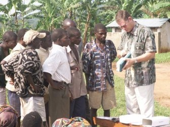 Teaching the Pigmy men to use a crank cassette to listen to the gospel