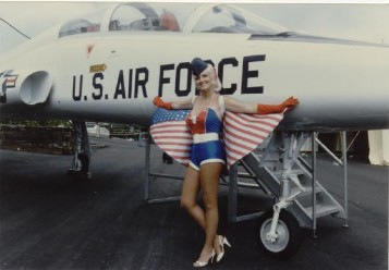air force pin up in front of jet